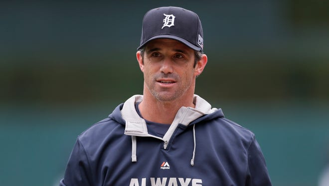 Detroit Tigers manager Brad Ausmus watches during practice in preparation for Game 3 of baseball's American League Division Series against the Baltimore Orioles in Detroit Saturday, Oct. 4, 2014.