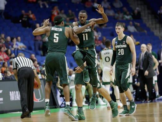 Michigan State teammates Cassius Winston and Lourawls