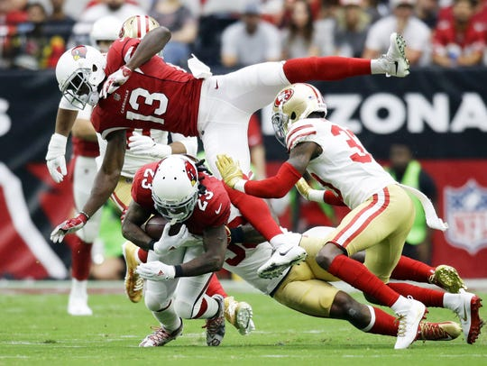 Arizona Cardinals running back Chris Johnson is tackled