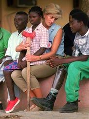 Britain's Princess Diana talks to amputees at the Neves