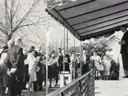 The Rev. Bill Barnes and Quincy Scoot led a worship service on front porch Edgehill United Methodist Church, which is located at 1502 Edgehill Ave. The photograph was taken around 1968.