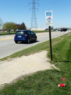 A CityBus stop in the 3800 block of Ind. 38 Friday, April 15, 2016, in Lafayette. There is no sidewalk access to this particular bus stop, only a well worn path in the grass.