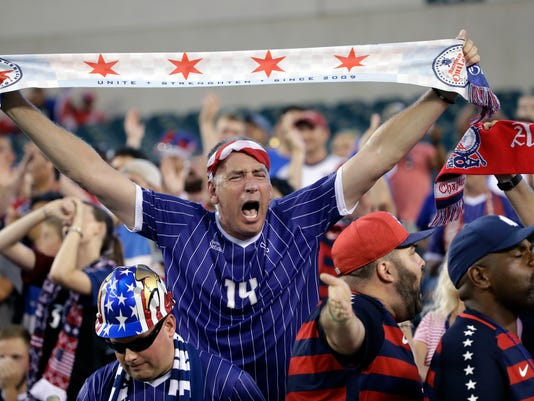 A United States fan cheers before a CONCACAF Gold Cup quarterfinal soccer match against El Salvador, in Philadelphia, Wednesday, July 19, 2017. (AP Photo/Matt Rourke)
