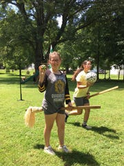 Quidditch seeker Celina Pugh from house Hufflepuff holds the golden snitch and chaser Margaret Carbajal from house Ravenclaw carries the quaffle during quidditch practice on Sunday, Aug. 13, 2017 at Mia and Chris Pugh's home in Churchville. The Pughs, of Medieval Fantasies Company, organize the Hogwarts Homecoming Quidditch Games and return as The Founders of Hogwarts for Staunton, Virginia's Queen City Mischief & Magic Sept. 22-24, 2017. During the games, Chris, Godric Gryffindor, will act as head referee and Mia, Helga Hufflepuff, will be score keeper. Founders Rowena Ravenclaw and Salazar Slytherin, Dianna and Dan Pittman, will also assist in the games.