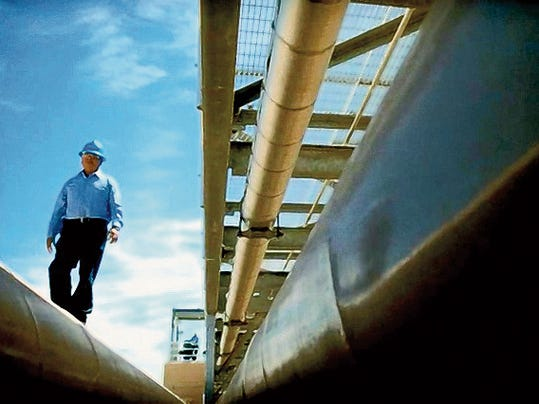 """An El Paso Water Utilities employee is shown at a water plant in a scene from a new TV commercial being used by the utility as part of its """"Water Forever"""" ad campaign."""
