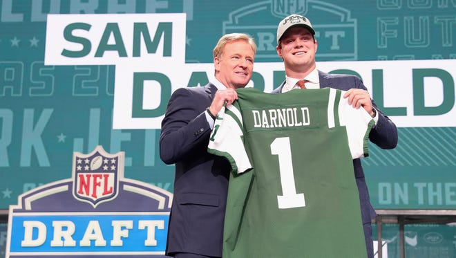 USC quarterback Sam Darnold poses with NFL Commissioner Roger Goodell after being picked No. 3 overall by the New York Jets.