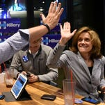 Marc Feinstein high-fives Stacy Newcomb-Weiland after Hillary Clinton was announced the winner for the South Dakota primaries during the election night watch party at Shenanigans in western Sioux Falls on Tuesday.