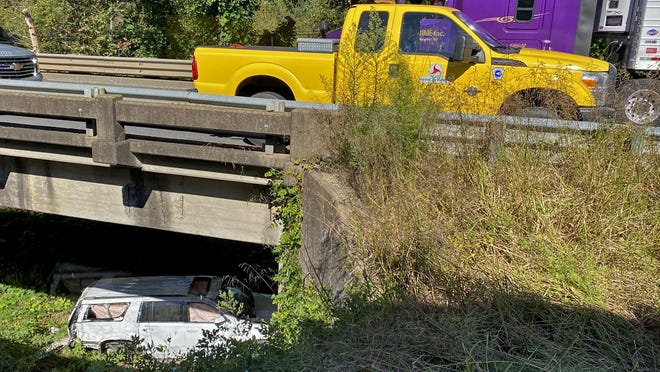 A vehicle sits under the Buffalo Creek bridge on U.S. 74 on Friday.