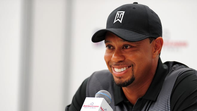 Tiger Woods speaks to the media during a press conference in advance of the Quicken Loans National golf tournament at Quicken Loans National Media Center.