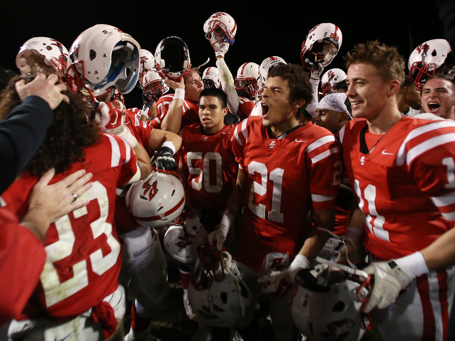 Players celebrate after Palm Springs defeated Oak Hills in their CIF semifinal football game at Palm Springs High. The Indians won 27-23.