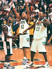 Before the Flintstones took off in 1997-98, MSU had been mostly a middling Big Ten basketball program since Magic Johnson left. Here Mateen Cleaves, left, Morris Peterson, center, and Antonio Smith celebrate in 1998.