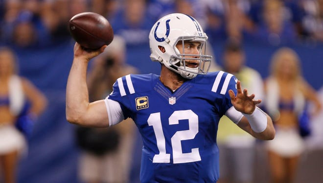 Indianapolis Colts quarterback Andrew Luck (12) throws a pass against the San Diego Chargers at Lucas Oil Stadium.