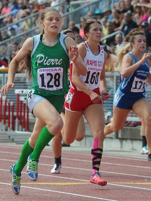 Pierre's Cortney Dowling outruns the competition to win the 100-meter dash at Howard Wood Field during the South Dakota State Track and Field Meet on Saturday, May 31, 2014.