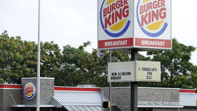 Burger King announced Tuesday that it  agreed to merge with the Canada-based Tim Hortons.