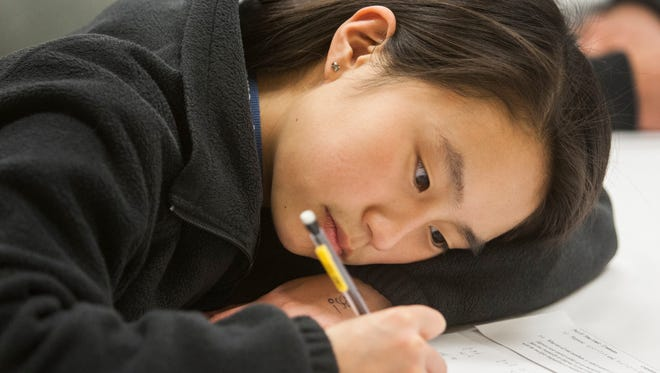 Archmere competitor Raylin Xu works on a problem at the Math League High School Invitational.