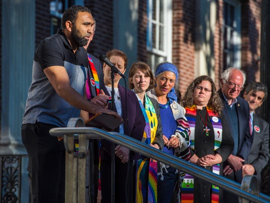 Imam Islam, left, of the Islamic Society of Vermont
