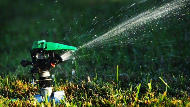 Sprinkler guidelines limit watering to two days a week during Daylight Savings time and to one day a week during Eastern Standard Time. MALCOLM DENEMARK/FLORIDA TODAY