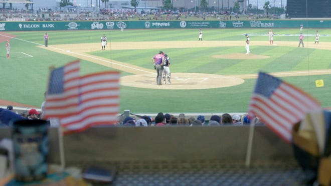 """A 2019 game of Tecolotes de los Dos Laredo, a binational professional baseball team with home stadiums in Nuevo Laredo, Mexico, and Laredo, Texas, appears in a scene from """"Bad Hombres."""" The new Showtime sports documentary follows this AAA Mexican League baseball team that plays on both sides of the U.S.-Mexico border amid the tension around migration, divisive politics, and environmental concerns."""