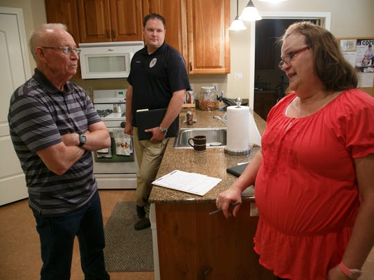 Washington County Sheriff's Dept Detective Richard Triplett, left, and St. George Police Department detective Adam Olmstead discuss their cases with Utah Division of Child and Family Services investigator Christie Howes, right, as they stand in the kitchen of the Children's Justice Center in St. George Friday, April 11, 2014.