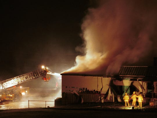 Firefighters fight a fire at the Greenville Country Store on May 2, 2001.