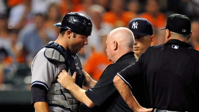 Yankees catcher Austin Romine suffered a mild concussion after taking a foul tip off his mask against the Orioles on Tuesday.