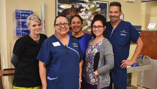 Adelaida Mier, clinic manager at the Fresenius Kidney Care of Alamogordo, stands with her staff who she credits made it possible for her to volunteer two weeks in Puerto Rico.