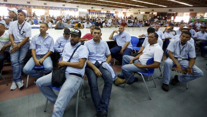Workers of General Motors listen during a meeting with government officials at the company's plant in Valencia, Venezuela, Thursday, April 20, 2017.