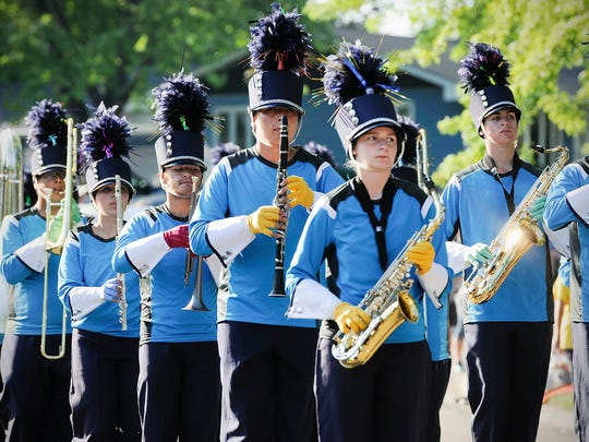 The Solar Sound Marching Band, St. Cloud, prepare for their run past the judges during the Sauk Rapids River Days Parade.