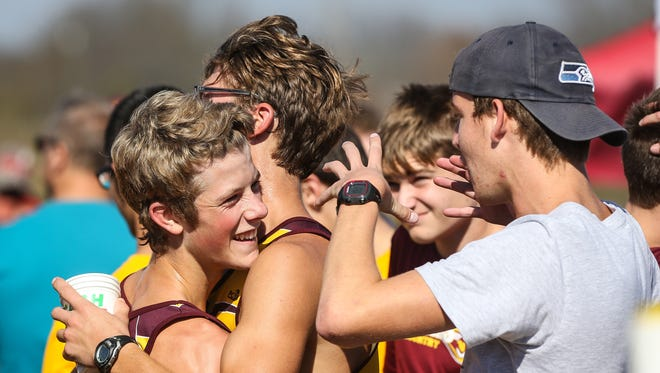 The Cooper boys' cross country team has a lot to be happy about, after winning the Class 3A race at the Fall Brawl Regional Cross Country Championship at Sherman Elementary School, Saturday, October 29, 2016.