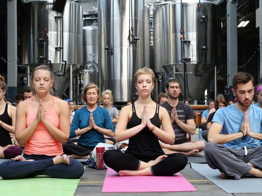 On Sunday morning, the Rhinegeist Brewery in Over-The-Rhine transforms to yoga mats and finding your center.