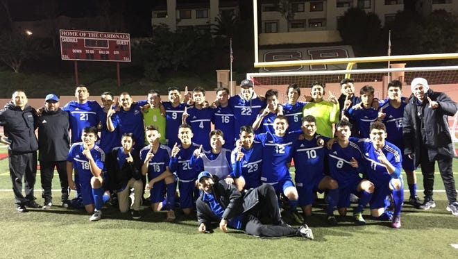 The Fillmore High boys soccer team celebrates winning its first Tri-Valley League championship since 2004 with a 1-1 tie at Santa Paula on Feb. 8, 2017.