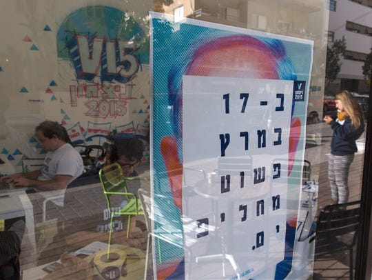 A poster at the offices of V15 shows a picture of Benjamin