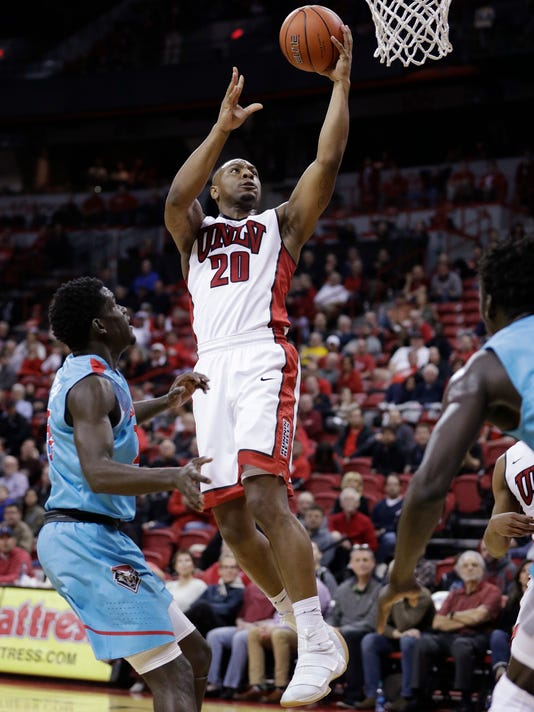 UNLV's Christian Jones shoots in front of New Mexico's Damien Jefferson during the second half of an NCAA college basketball game Wednesday, Feb. 1, 2017, in Las Vegas. (AP Photo/John Locher)