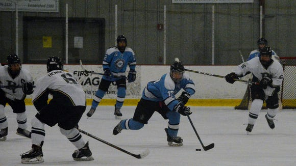 Suffern forward Evan Cama looks to break out during