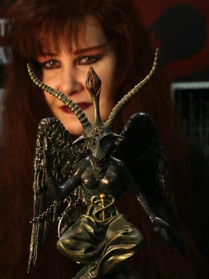 Cindy Fleming, a member of Temples of Satan in Detroit shows the idol named Baphomet, which represents Satan as a goat-headed figure.