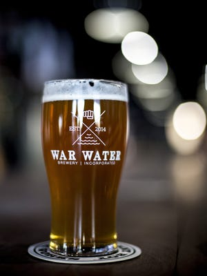 A beer sits on the bar at War Water Brewery in the Riverview Plaza in St. Clair.