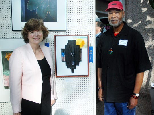 Union County Freeholder Bette Jane Kowalski congratulates Frank B. Marshall III of Roselle on winning first place in the professional mixed media category at the annual Union County Senior Citizens Art Exhibit during the opening reception in the Atrium of the Elizabethtown Gas Company Liberty Hall Center in Union. In addition, Linda Rosen of Cranford won first place in the professional acrylic category and Thomas Wacaster of Clark won first place in the nonprofessional oil category and nonprofessional Best in Show. The exhibit will be on display until July 12 at Liberty Hall Center, at 1085 Morris Ave. in Union. Viewing times are from 9 a.m. to 5 p.m. Monday through Saturday.