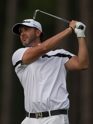 Scott Piercy hits his tee shot on the 17th hole during the final round of the Barbasol Championship golf tournament Sunday. Piercy finished 6-under 65 for a three-stroke victory and his third PGA title.