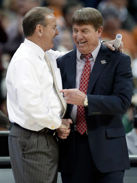 North Carolina State coach Wes Moore, right, congratulates Mississippi State coach Vic Schaefer following a women's NCAA college basketball tournament regional semifinal Friday, March 23, 2018, in Kansas City, Mo. Mississippi State won 71-57. (AP Photo/Orlin Wagner)