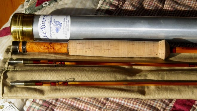 Hand made reel seat and ferrules and a unique signature flaming pattern are hallmarks of a Menscer fly rod.