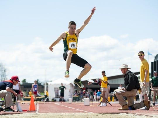 Vermont's Ian Weider competes in the long jump during the America East outdoor track and field championships at the Frank H. Livak Track on Saturday May 7.