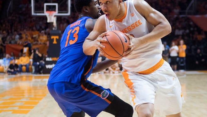 Tennessee's Grant Williams works his way around Florida's Kevarrius Hayes on Wednesday, February 21, 2018.