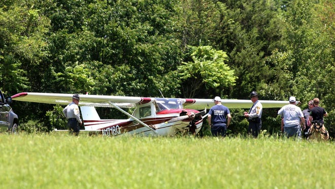 Police and first responders arrive on the scene of an emergency plane landing off Eaves Road on Monday. The pilot was not hurt during the landing.