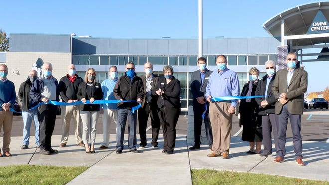 Representatives of Omni Community Credit Union, along with city and community officials, were present Wednesday to dedicate Omni's new branch at 1313 S. Centerville Road.
