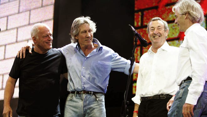 """Pink Floyd's Dave Gilmore (from left), Roger Waters, Nick Mason and Rick Wright appear on stage at the end of their set  at the Live 8 concert on July 2, 2005, in Hyde Park,  London. This lineup recorded Pink Floyd's classic albums, including """"Meddle."""""""