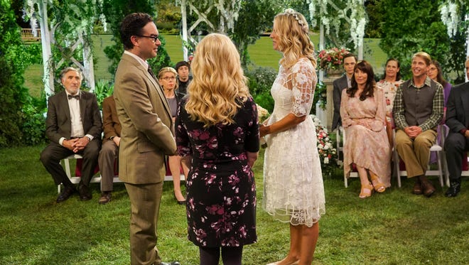 Leonard (Johnny Galecki), left, and Penny (Kaley Cuoco in wedding dress) exchange vows before friends and family in the Season 10 premiere of CBS' 'The Big Bang Theory.'