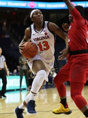 Virginia guard Jocelyn Willoughby (13) drives against Louisville guard Jazmine Jones (23) during the first half of an NCAA college basketball game Thursday, Feb. 21, 2019, in Charlottesville, Va. (AP Photo/Zack Wajsgras)