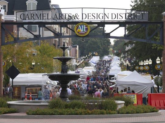 Festival goers walk around the Carmel International Art Festival.