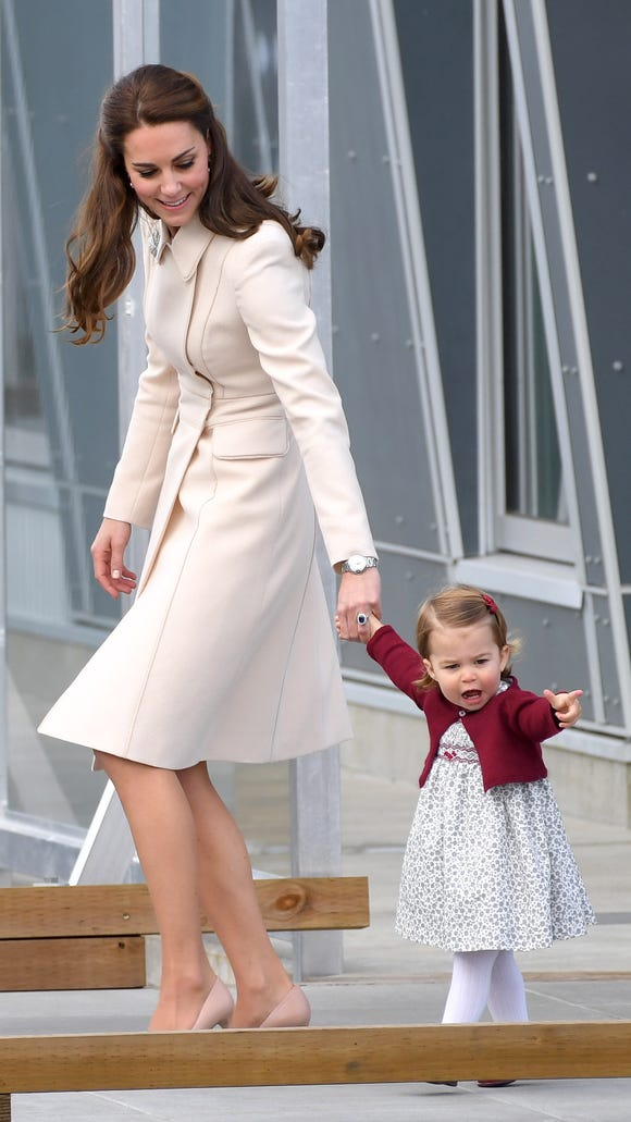 Kate in a Catherine Walker coat dress for departing Canada on Oct. 1. Princess Charlotte is wearing another smocked dress with wine-colored cardigan and shoes.