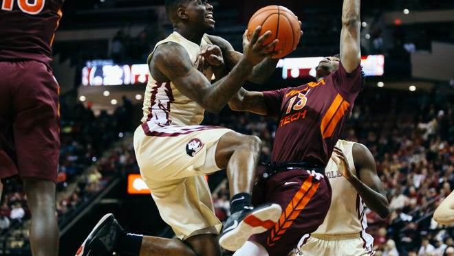 Dwayne Bacon (4) drives to the basket during Florida State's 93-78 win over Virginia Tech in Tallahassee, Fla. on Saturday, January 7, 2017.